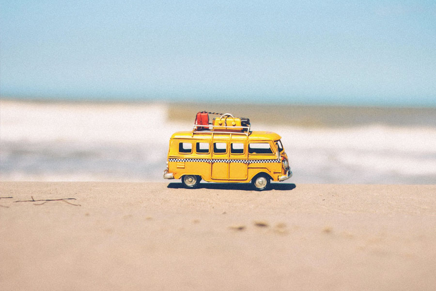 bus toy on the beach